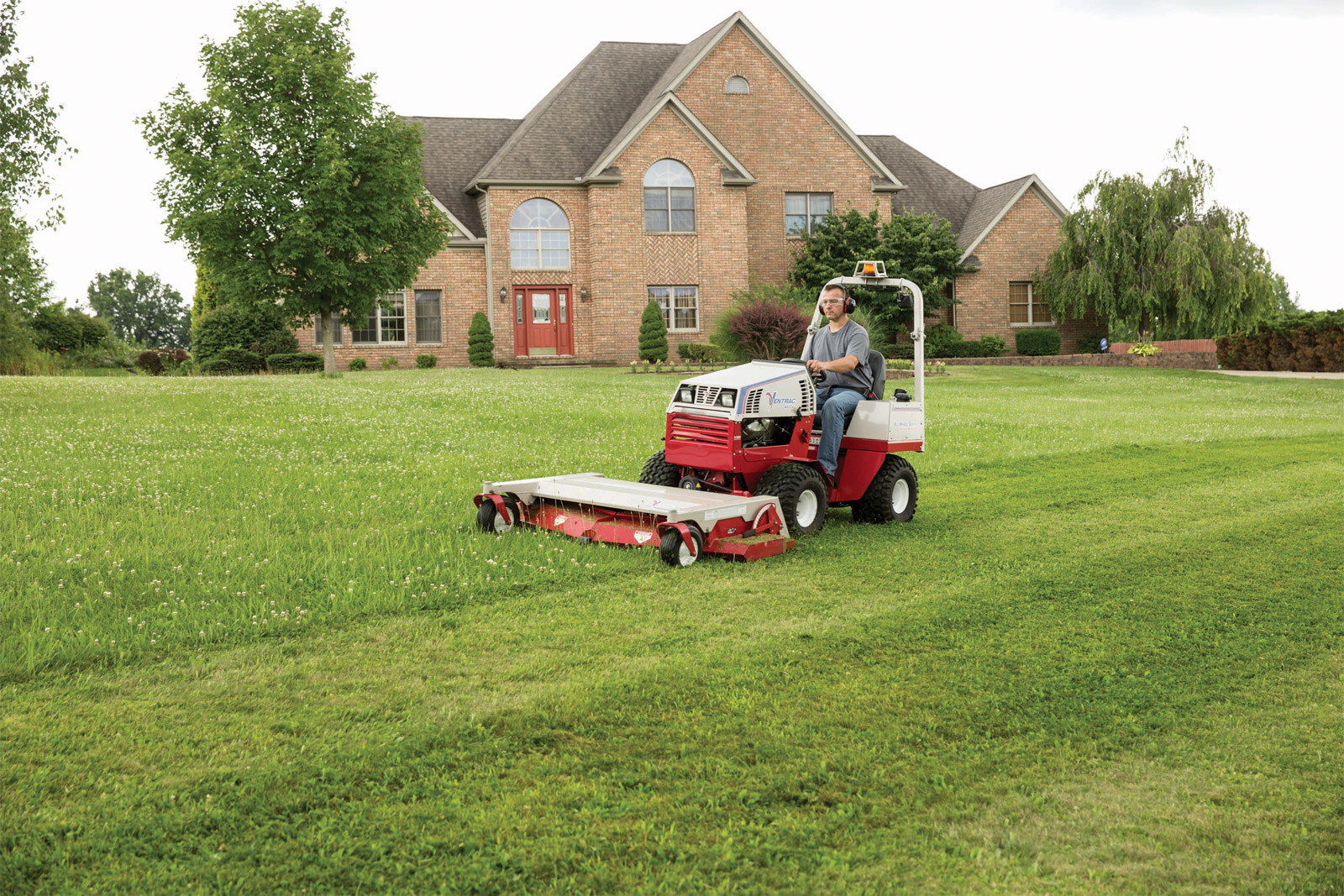 Large manicured lawn with HM722 attachment on Ventrac 4500 tractor